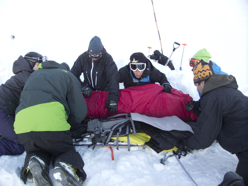 Loading a victim on to a Brooks Range safety sled