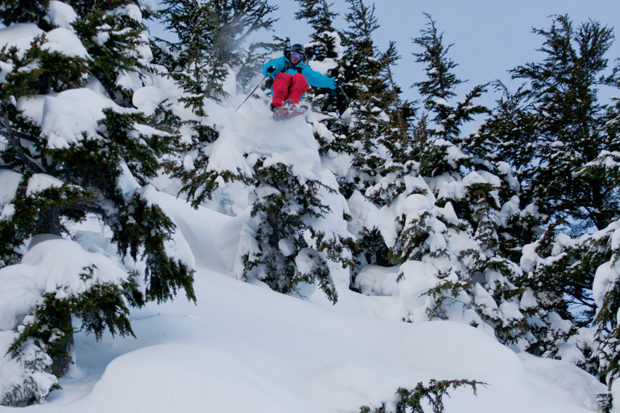 Tim Durtschi taking advantage of the tree pillows that the cat skiing zone has to offer.