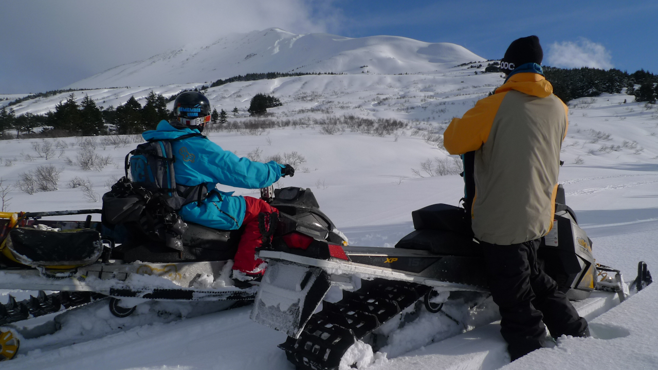 Tim Durschi And Dash Longe With Snowmachines In Ak