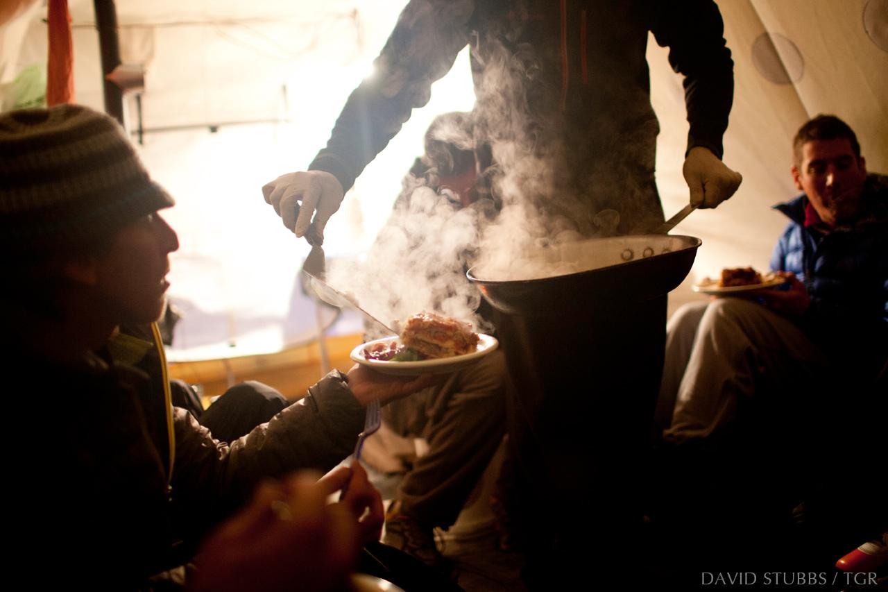 Jeff Dostie serves up lasagna. Photo by David Stubbs