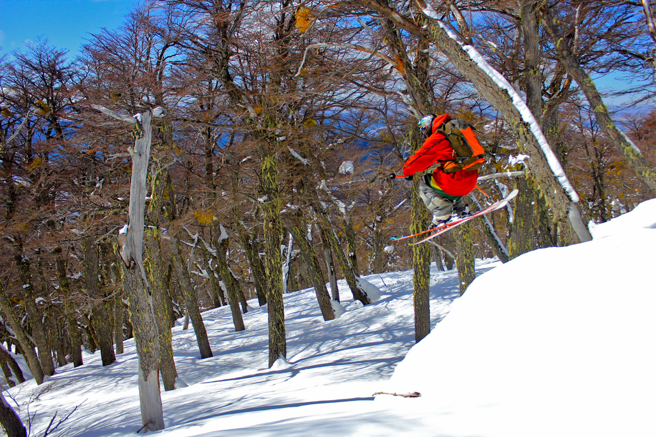 Andres Labbozzetta boosts in the Cerro Catedral trees by Ryan Dunfee