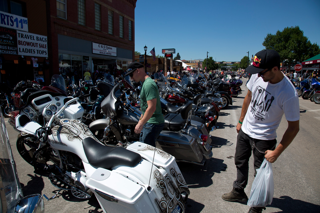 X Games Gold Medalist, Chad Kagy and Pro Mountain bike freerider, Aaron Chase check out the bikes in Sturgis