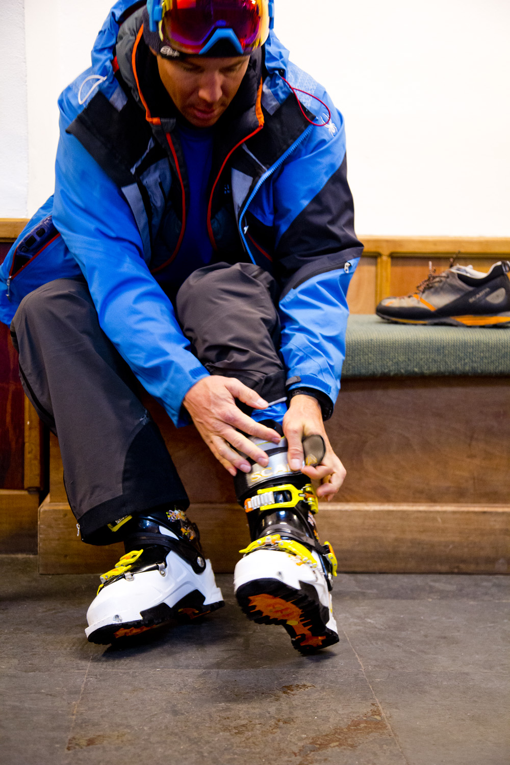 Chris Davenport puts on Scarpa boots. Photo by Adam Clark