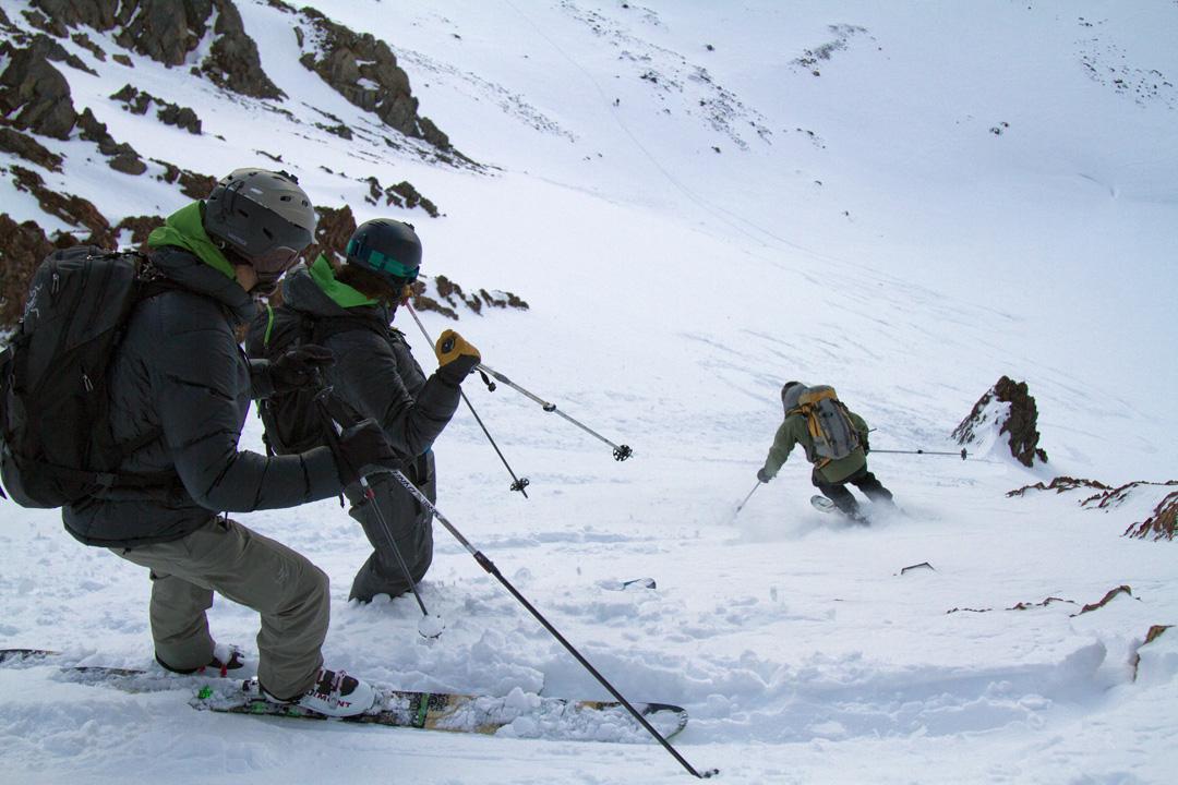 Jeff Dostie and Brennan Lagasse watch Toby Schwindt ski