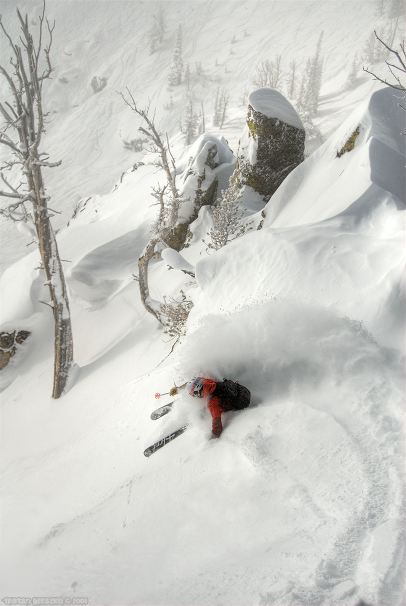A skier slashes a turn in in Jackson Hole photo by Tristan Greszko