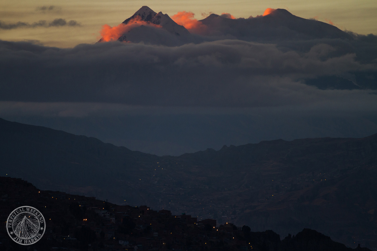 Sunrise on Illimani, Bolivia while the city of La Paz still sleeps. Photo by Jim Harris