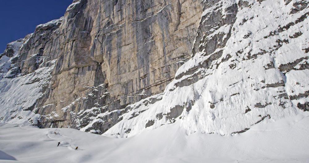 skiing-under-massive-cliff_FB-size.jpg