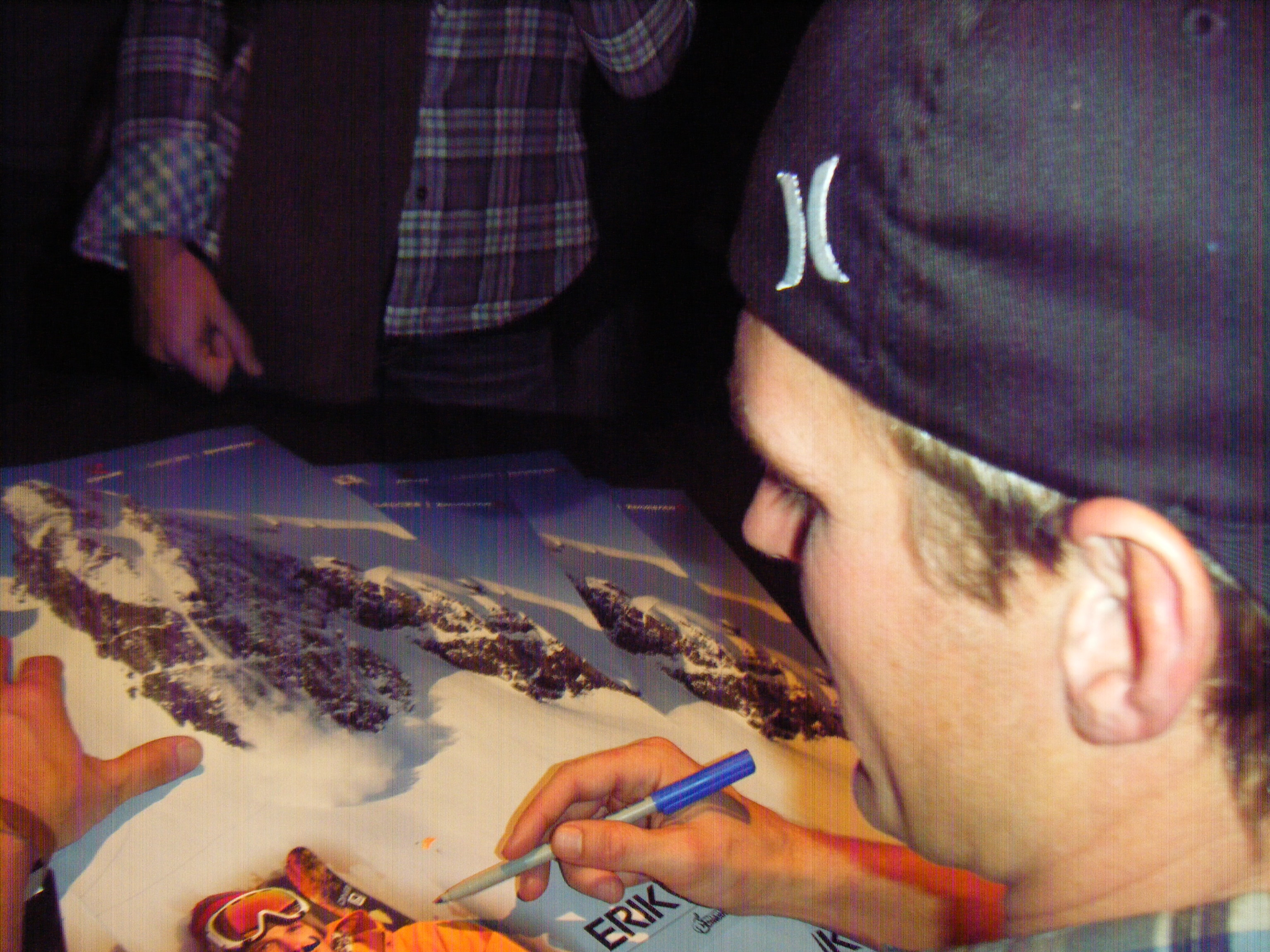 Erik Roner Signs Some Posters