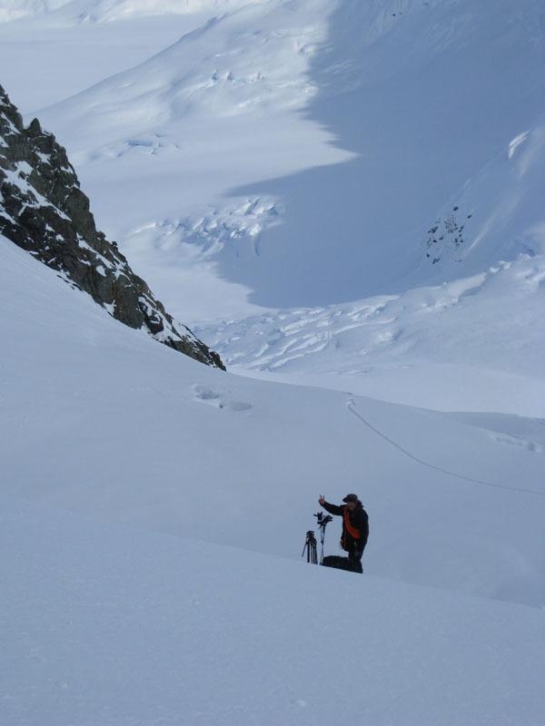 Garry getting ready to ride down glacier.JPG