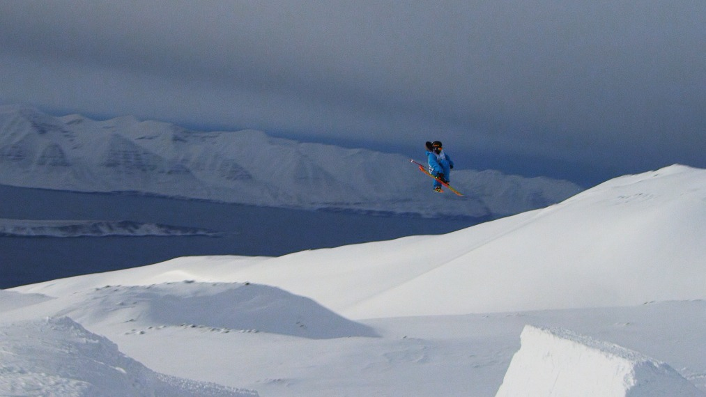 Byron Wells soaring over the Arctic Ocean