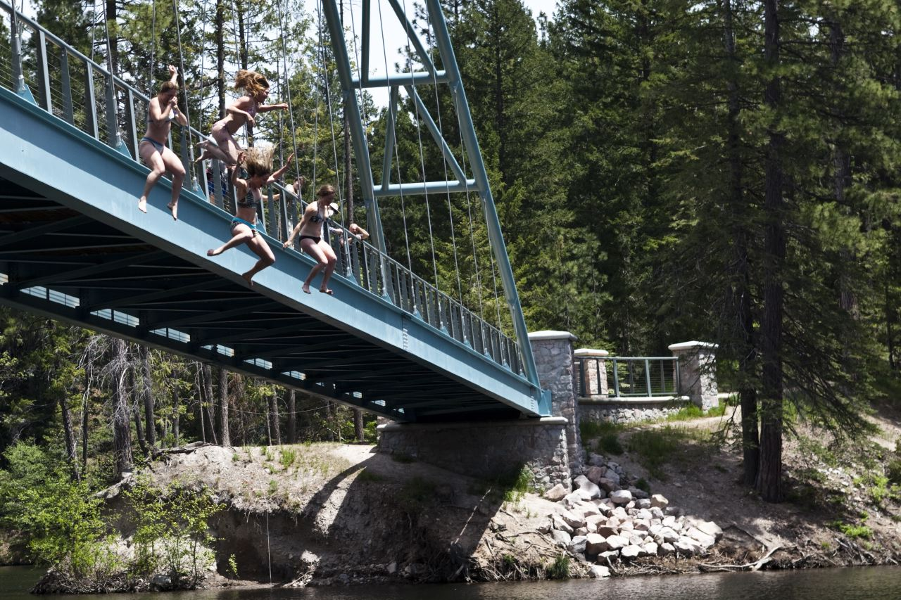 Jumping off a bridge near mount Shasta by Patrick Orton