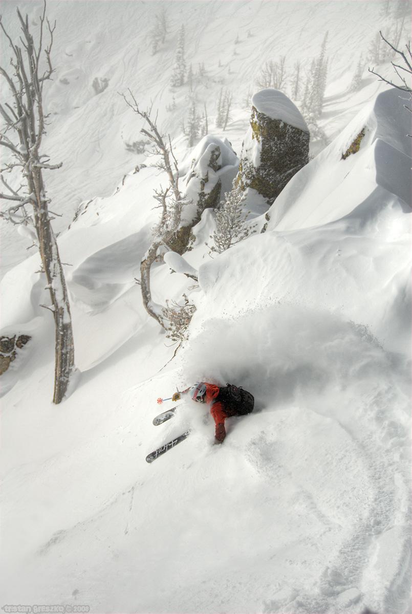 A skier slashes a turn in in Jackson Hole photo by Tristan Greszko