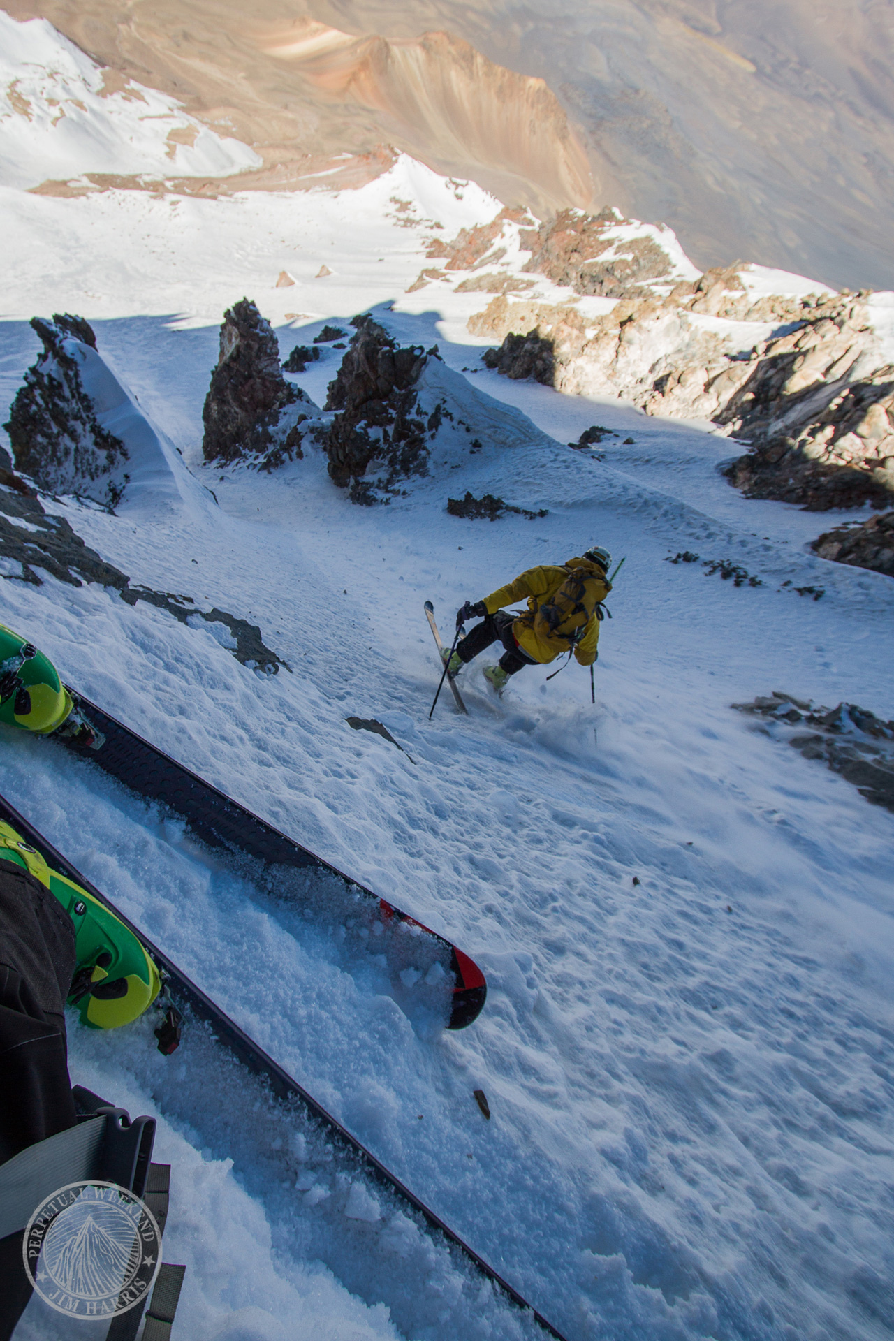 Alan Schwer hops down a steep ski line at 19,000 ft, Volcan Pomarape, Bolivia. Photo By Jim Harris
