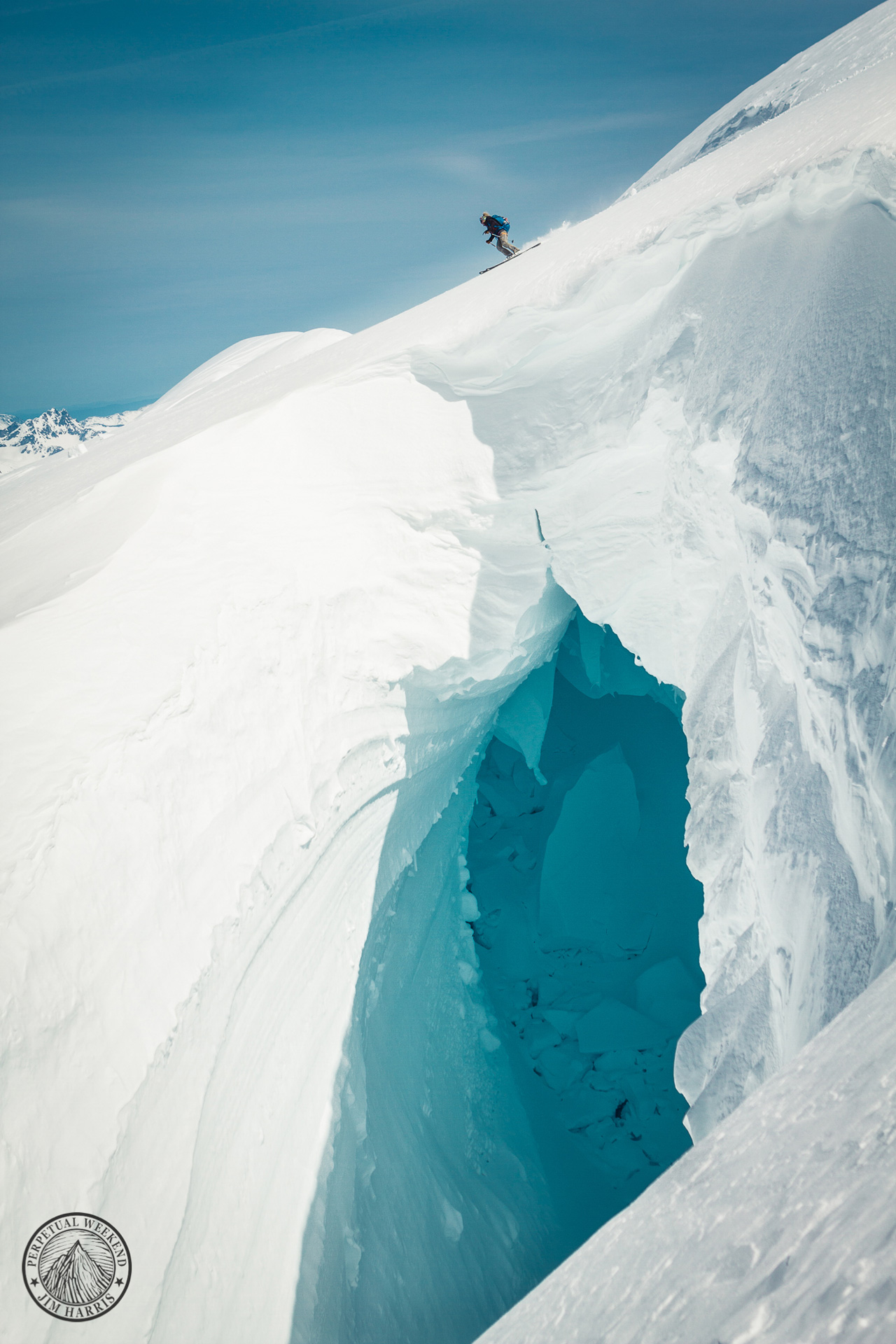 Solveig Waterfall skiing from the summit of Mt Waddington, BC over a cavernous crevasse. Photo by Jim Harris